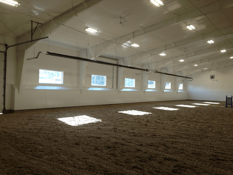 Steel building interior with windows, riding arena