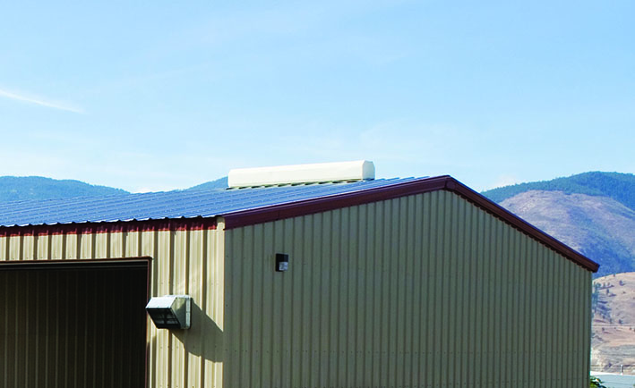 Steel building with white ridge vent on PBR roof