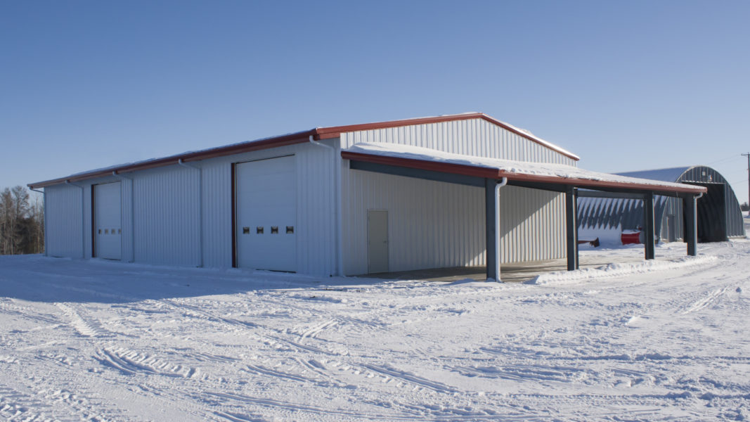 White Steel Building in snow