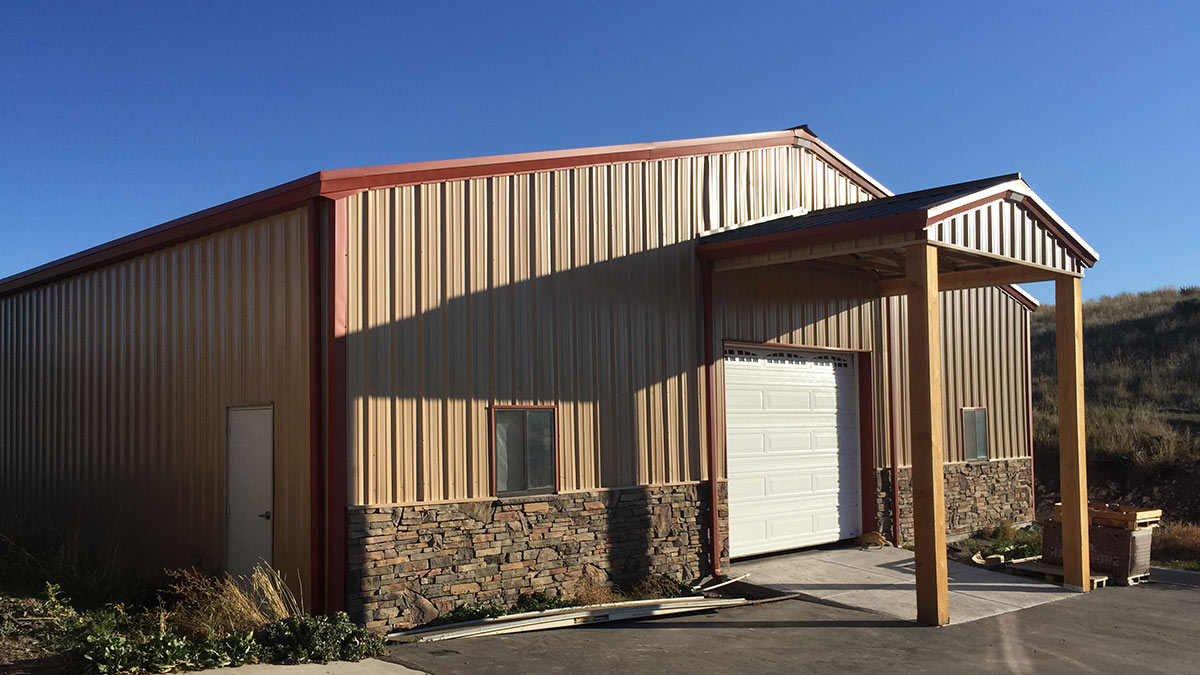 Tan steel building with red trim, Utah Steel Buildings