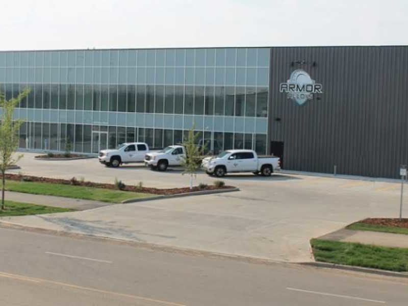 Commercial Steel Buildings for Armor Alloys Office. 240x100 Gray Steel Building located in Edmonto Alberta, Canada