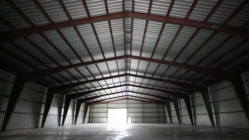 Beige 100x180x24 Agricultural Steel Building. located in Mactier, Ontario.