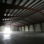 Beige 100x180x24 Agricultural Steel Building. located in Mactier, Ontario.