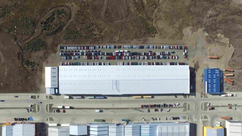large steel building warehouse in Chile, aerial view
