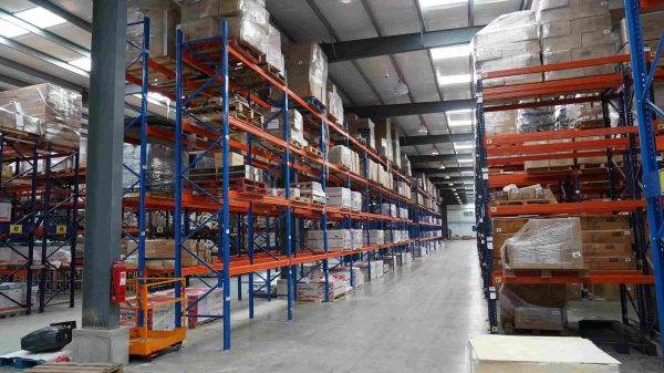 Steel building warehouse with racks for storage