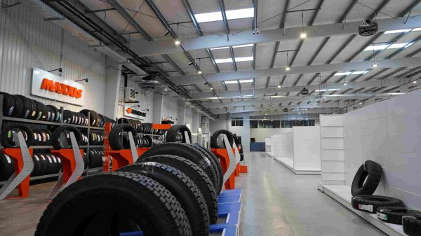 Steel building warehouse and showroom with tire racks for storage and display
