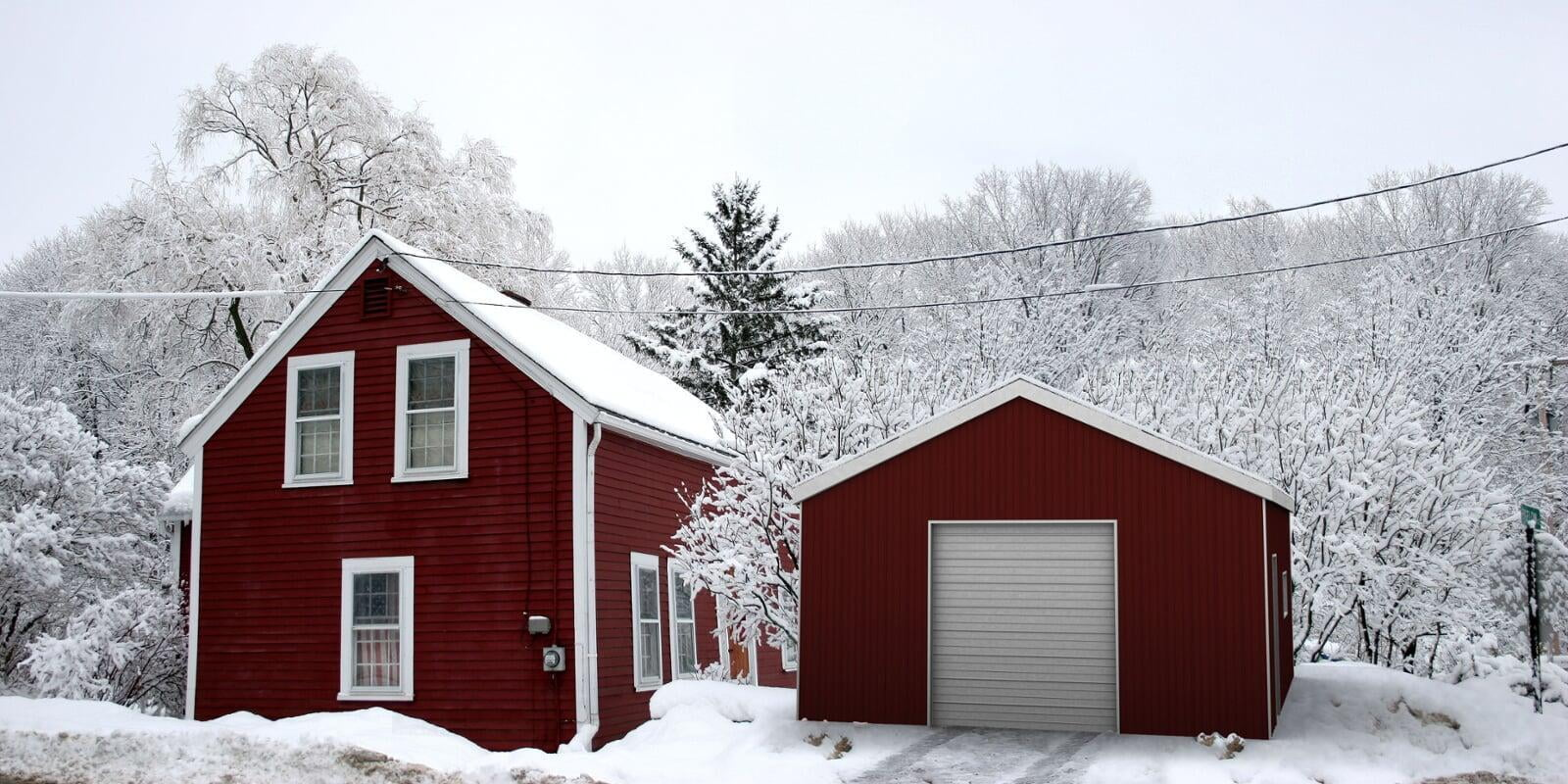 red steel building garage in the snow