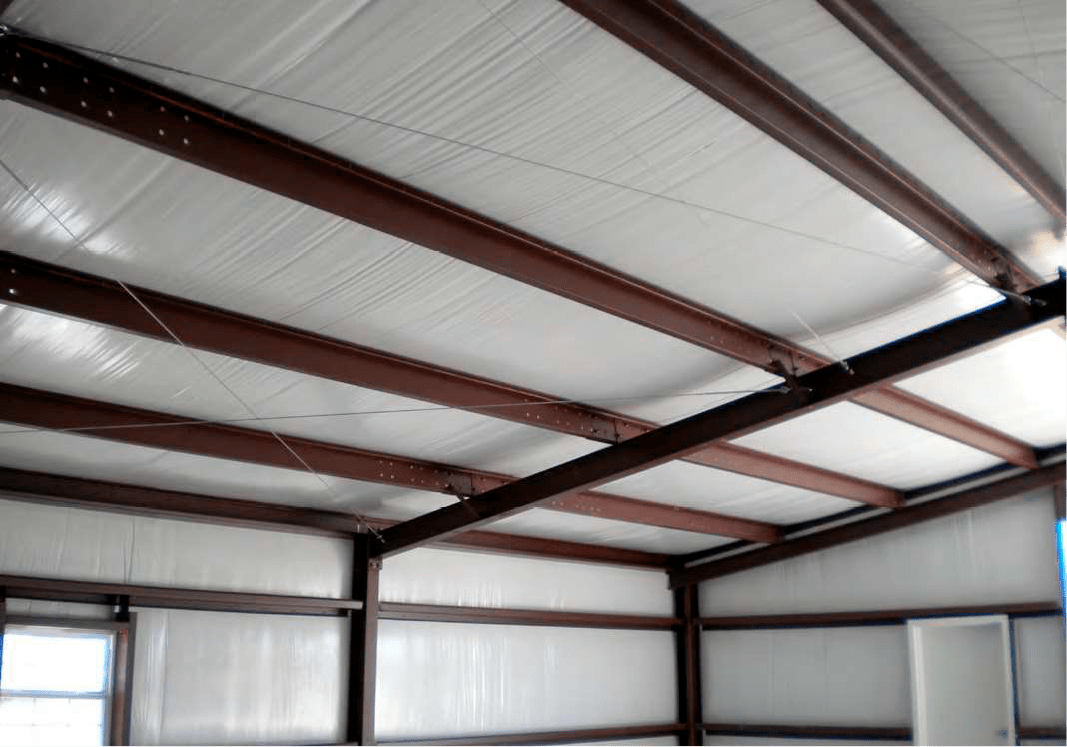 Steel building with vinyl backed fiberglass insulation