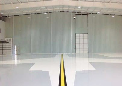Steel building with interior PBR liner panel and shiny tiled floor.