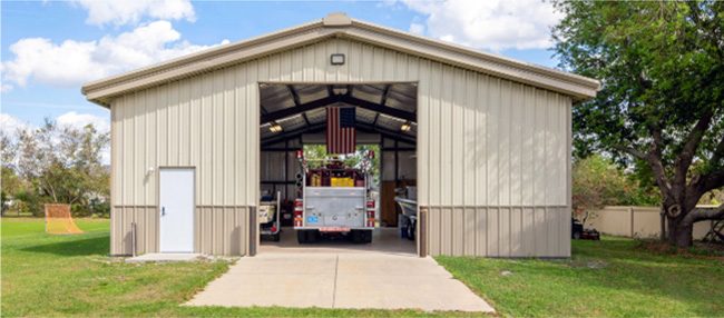 40x50x12 Tan gable steel building garage kit with wainscott, walk door, and overhead door.
