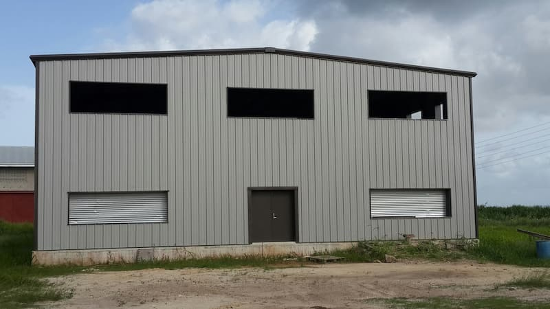 Steel building with framed openings