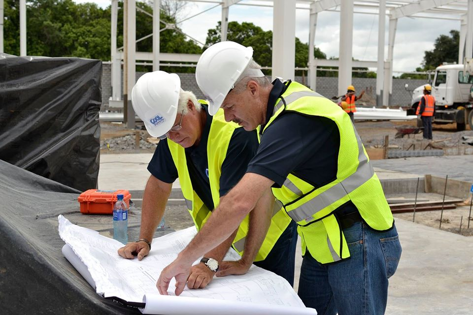 Allied Steel Buildings employees on jobsite conducting general compliance inspections