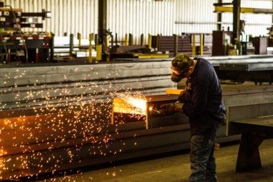 Allied Steel Buildings employee fabricating steel materials